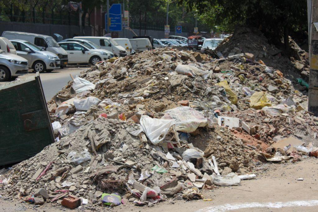 debris dumped at garbage bin
