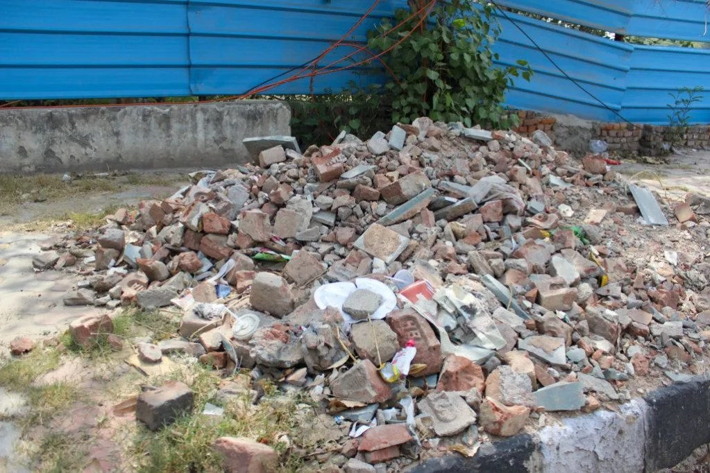 Malba dumped on footpath practically covering it