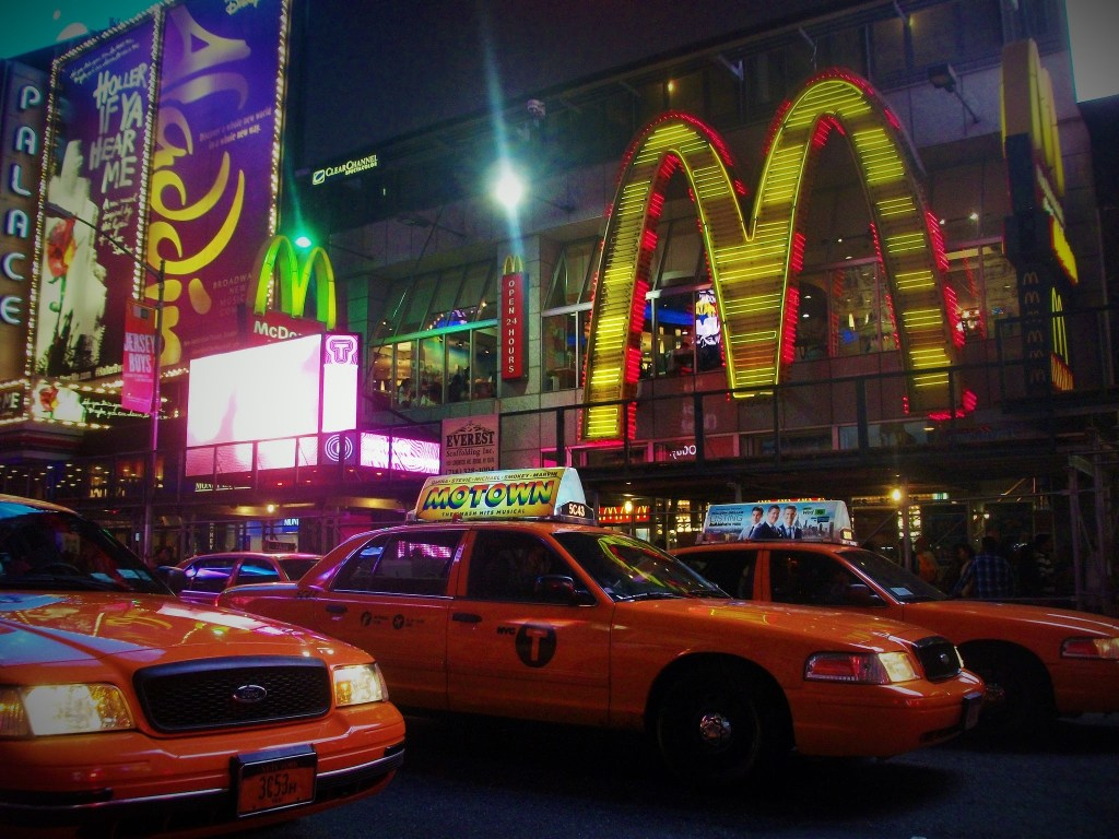 Yellow taxi cabs in the Times Square darkness