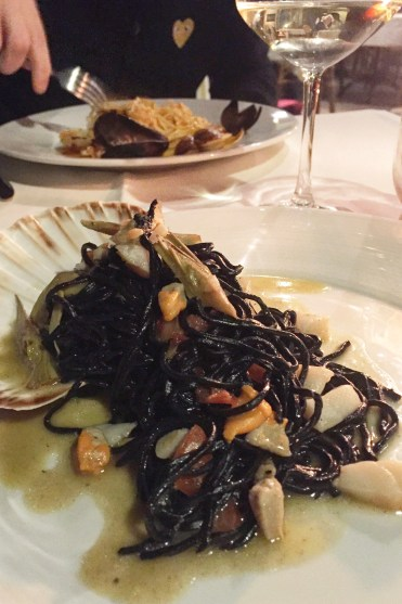 Squid ink tagliolini with scallops and artichokes