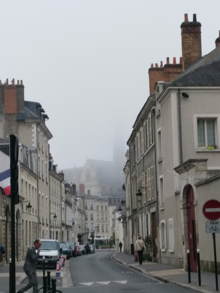 A typical European street filled with mist