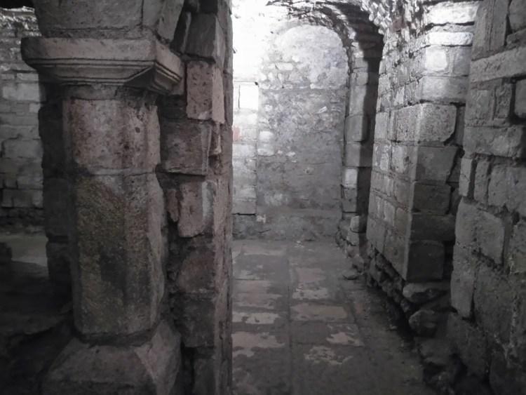 Dimly lit stone walls underground