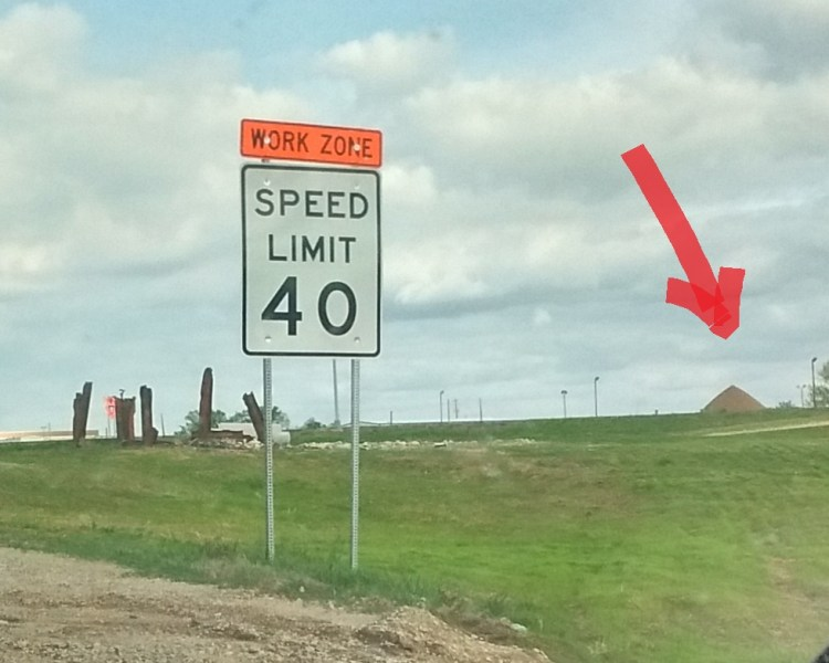 """Stonehenge and Pyramid Kansas markup. In this photo, a giant red arrow is used to point to the """"pyramid"""" in the photo."""