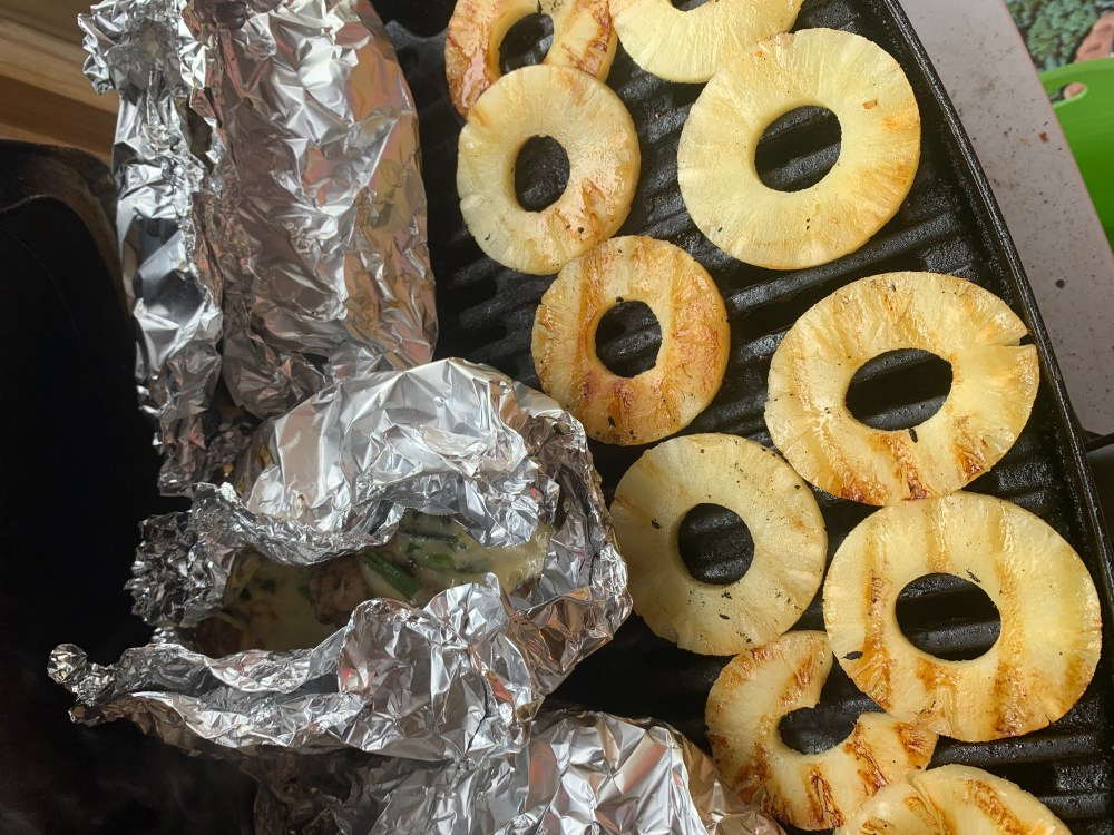 Pineapple slices on a grill