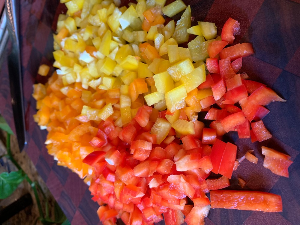 Picture of three colors of peppers diced small.