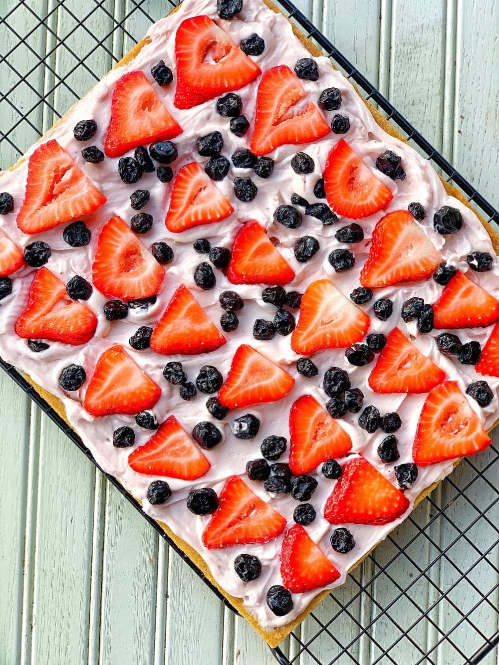 Picture of a cookie crust with cream cheese, strawberries, blue berries