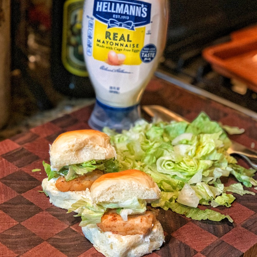 two sliders with a bottle of hellmann's mayo