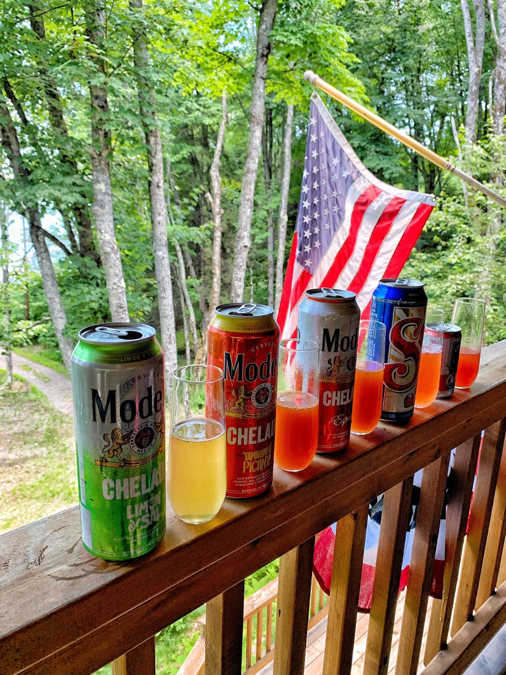 Picture of five cans of beer and an american flag