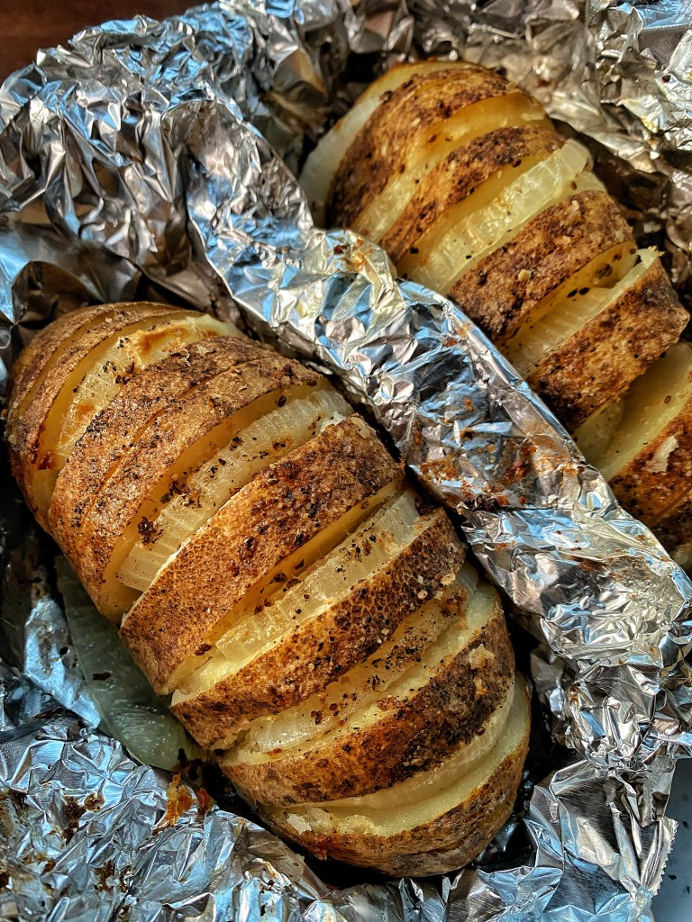 Two Idaho Russet Potatoes with onions, salt, pepper, herbs and spices and delicious melted butter.