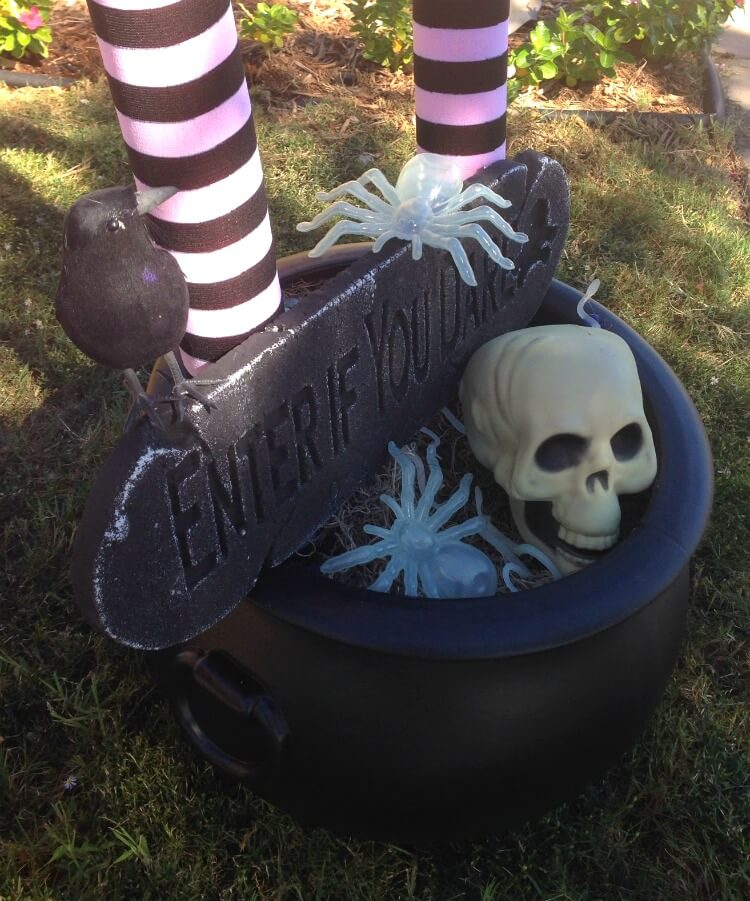 Get creepy items from the dollar store to top the cauldron like spiders, snakes, and a skull.