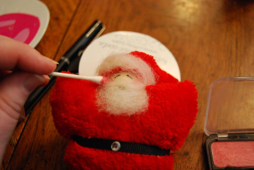 Give your Santa Christmas Ornament rosy cheeks.