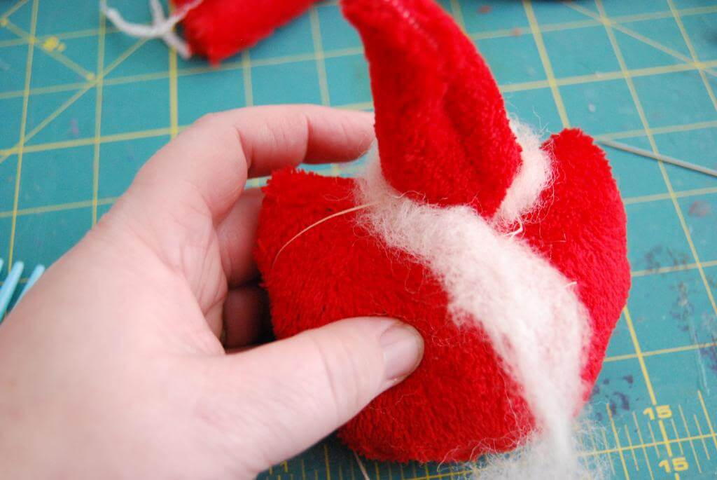 Give your Tiny Santa a wool-trimmed hat / hair.