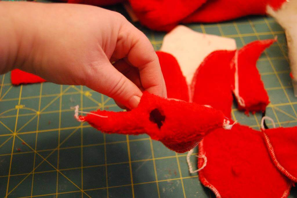 Cut a small hole in the center of the top as shown for the Tiny Santa's head.