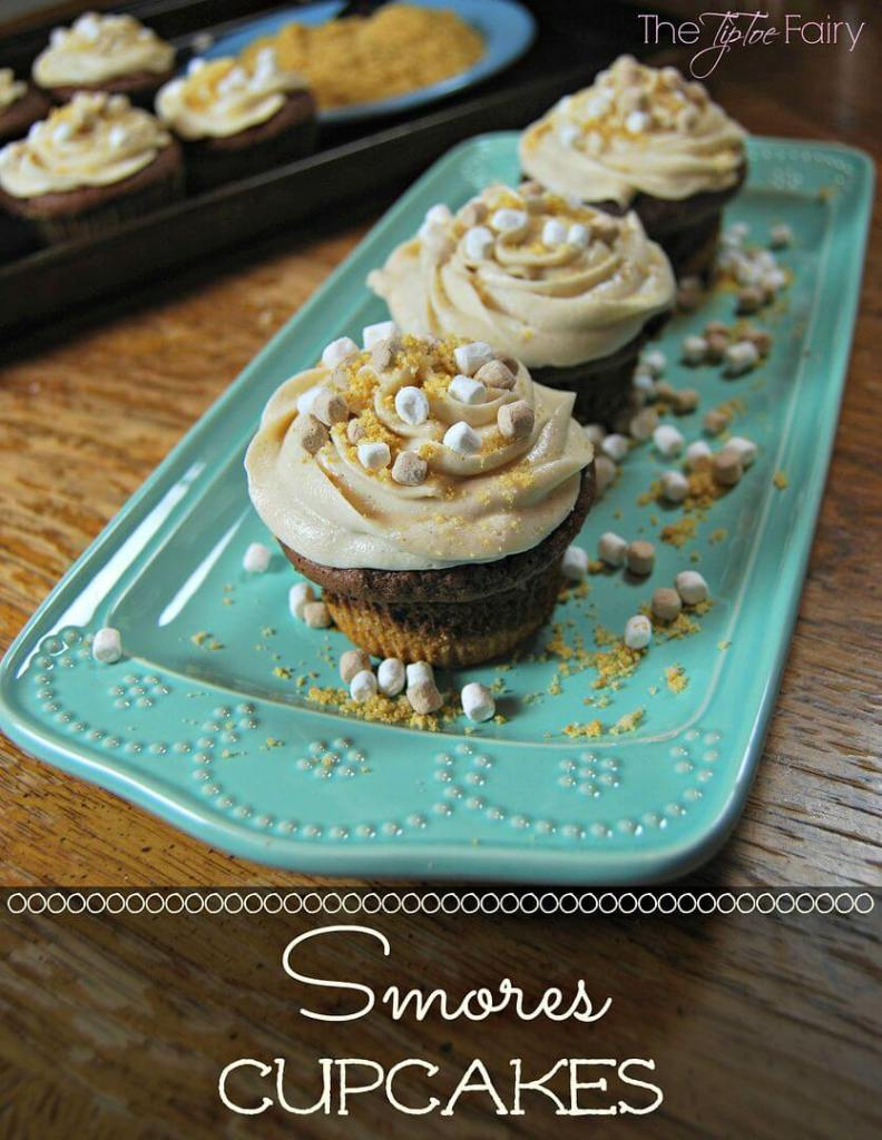Title image for S'mores Cupcakes with close up of finished cupcakes on an aqua plate.
