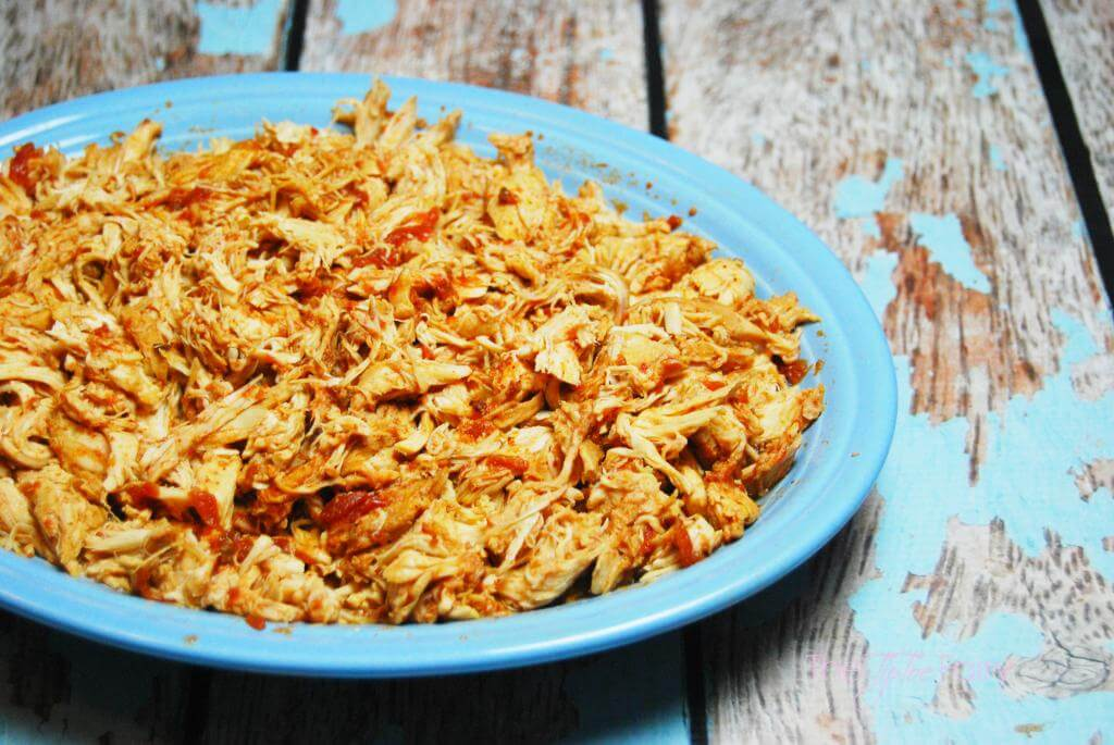 A big plate of shredded chicken made with just chicken breasts and salsa.
