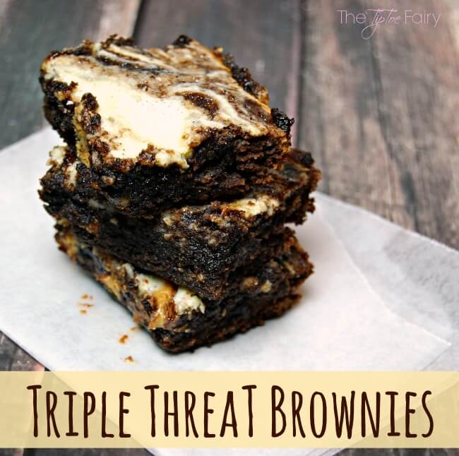 Triple Threat Brownies - filled with chocolate, peanut butter cups, and cheesecake. The perfect dessert! | The TipToe Fairy