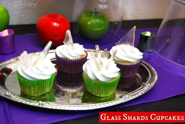Several cupcakes with sugar glass shards.