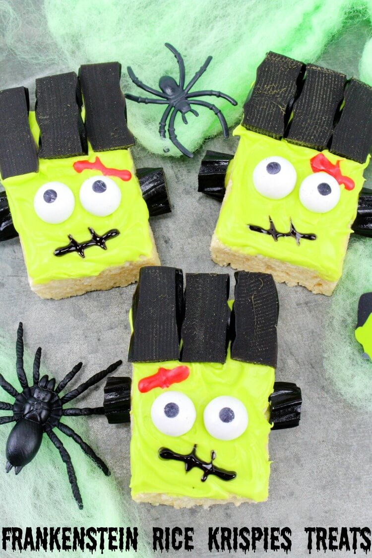 Three Frankenstein Monster Rice Krispies Treats with green spider webs and black spiders.