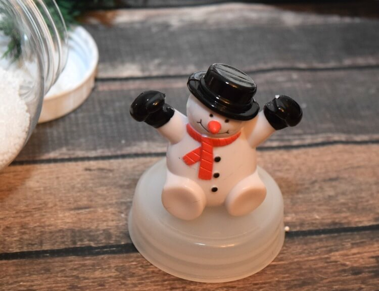 A snowman toy from my Christmas Snow Globe Wreath from @DollarTree & it lights up! #ad #DollarTree
