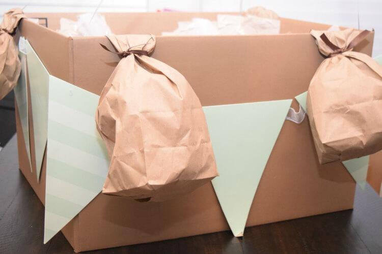 Attach lunch bag sandbags to box.