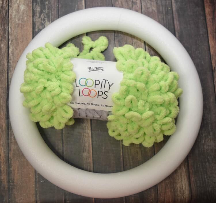 You will need 2 skeins of this loop yarn and a 16-inch styrofoam wreath.