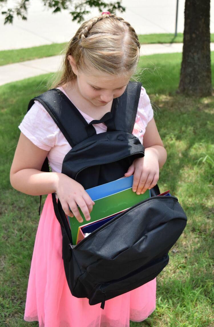 A backpack full of Big Box school supplies.