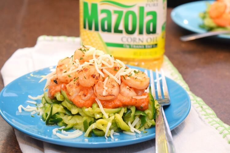 Shrimp and Zucchini Noodles topped with creamy tomato sauce.