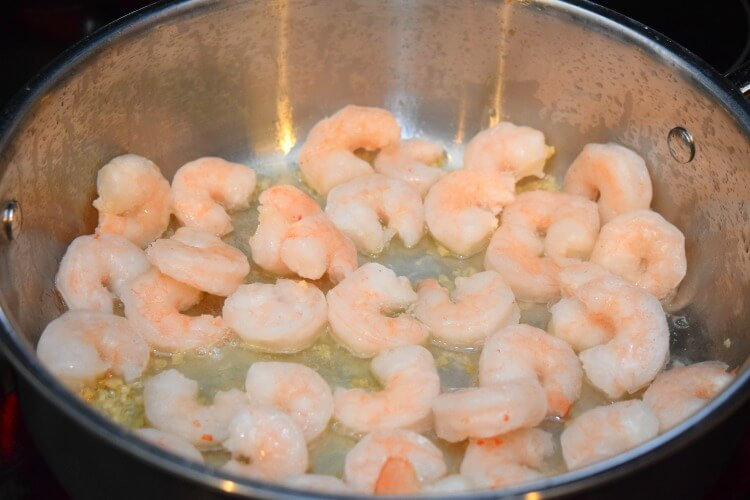 Sauteing the shrimp in Mazola Corn Oil and garlic.