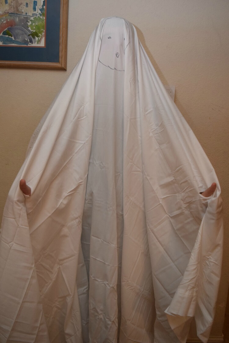 Turning a sheet into a ghost costume