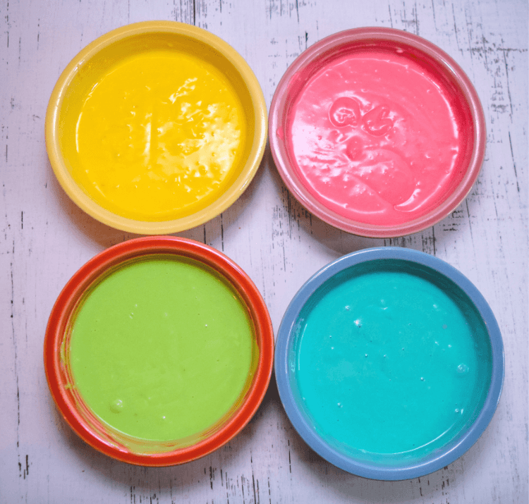 Cheesecake batter divided into four colors
