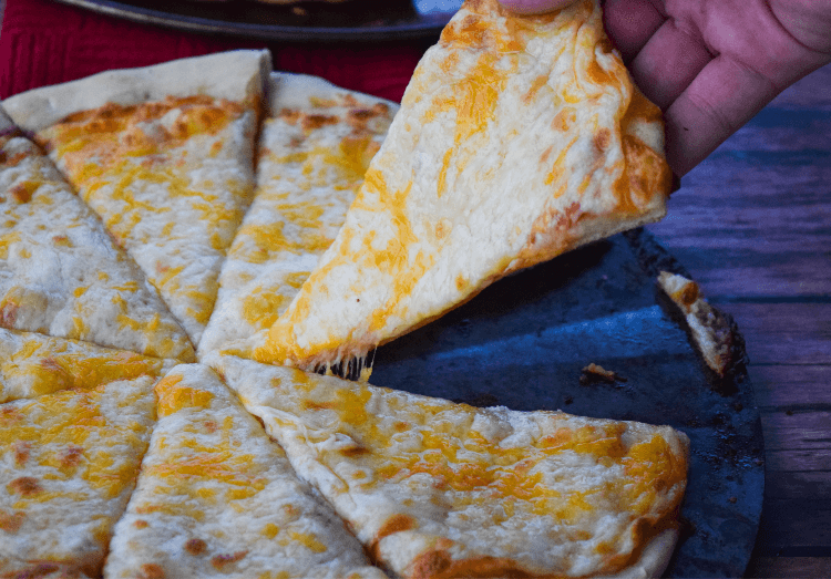 Gooey cheese pizza made fresh at home.