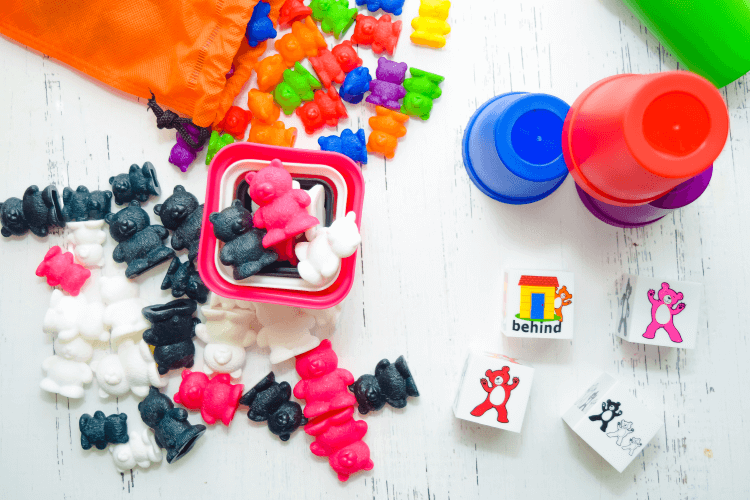 Sets of rainbow bears and pink, black, and white bears.