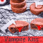 Vampire Kiss Cookies in a stick with a a Vampire Kiss Cookie sliced in half with the strawberry filling dripping down like blood with a pair of vampire teeth on top of the cookie.