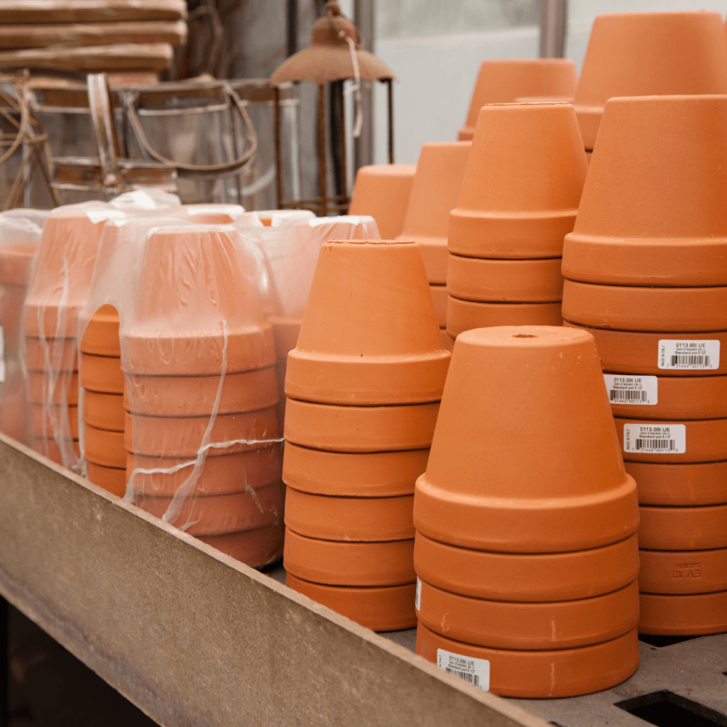 Stacks of terracotta pots in a store.