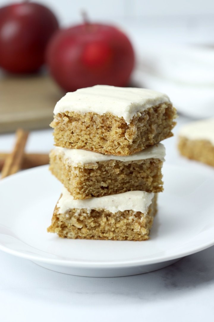 A stack of three applesauce bars on a white plate.