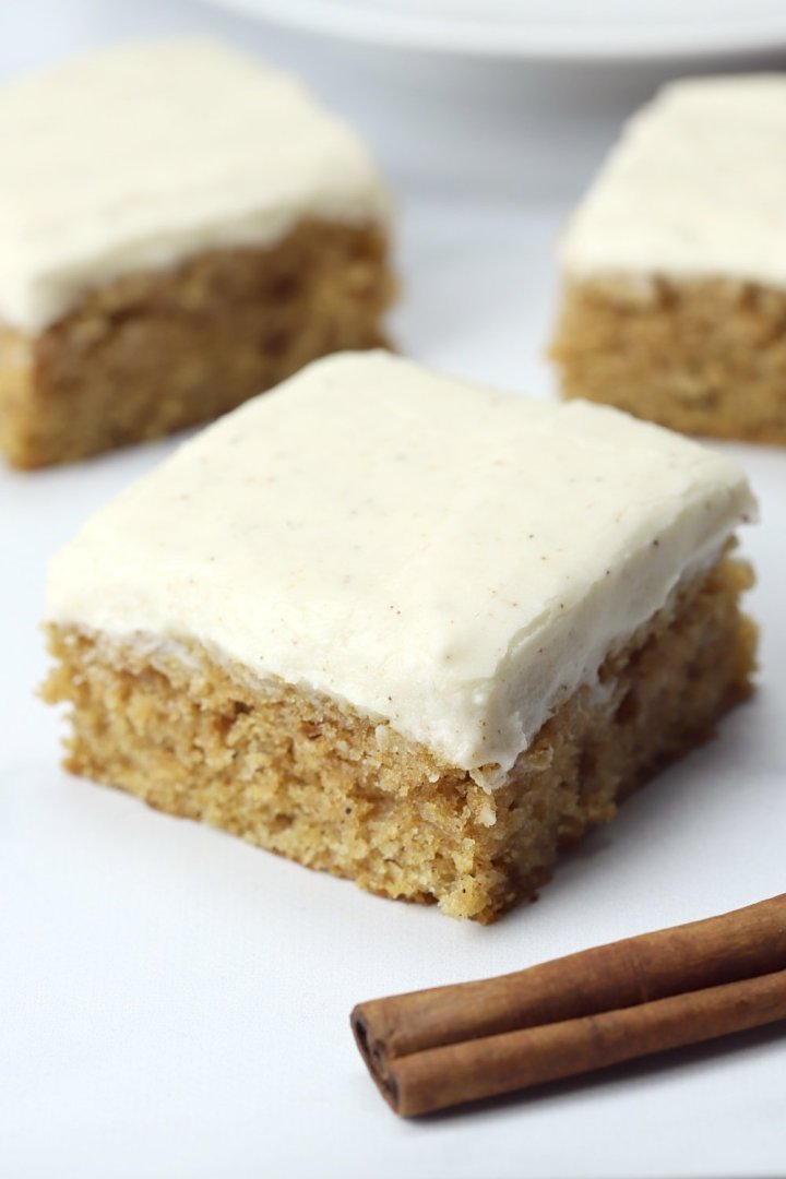 Applesauce bars with cinnamons ticks on a marble counter top.