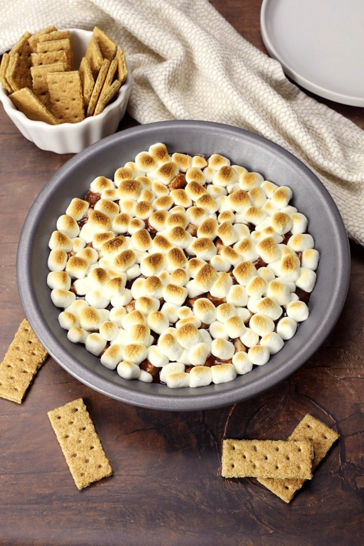 Easy s'mores dip with graham crackers ready for dipping.