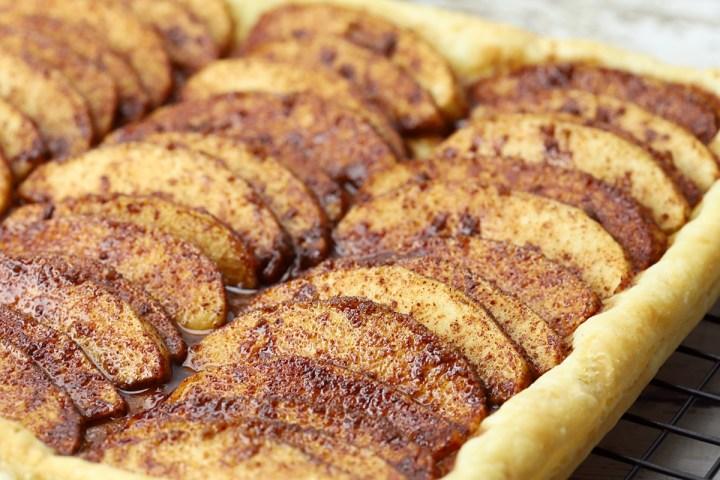 Apple slices on top of tart.