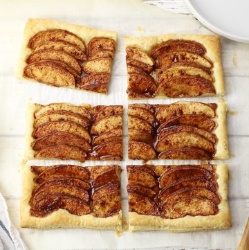 Puff pastry apple tart sliced into six pieces.