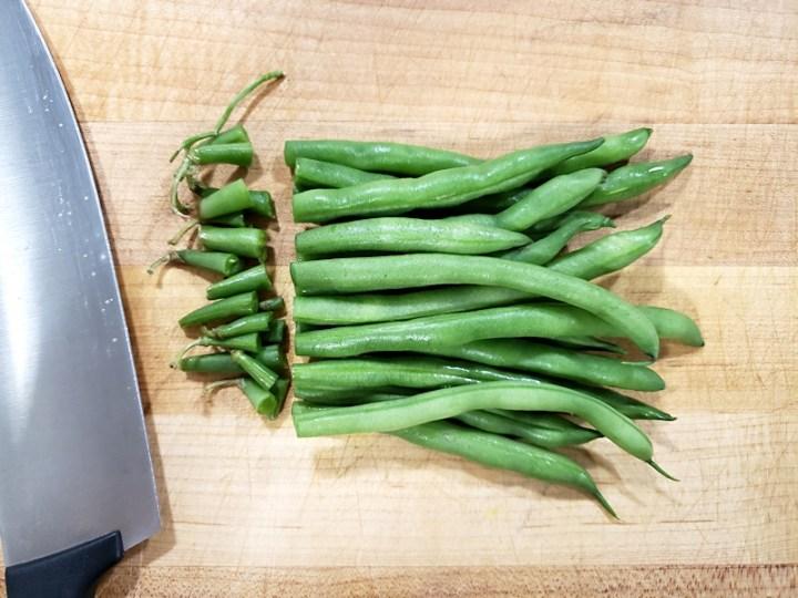 Stems sliced off green beans.
