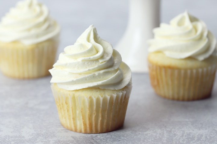Cupcakes topped with whipped buttercream frosting.