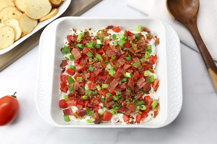 A white 8x8 dish filled with BLT dip.