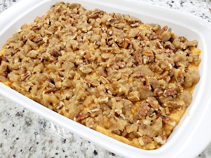 Casserole topped with pecan crumble topping.