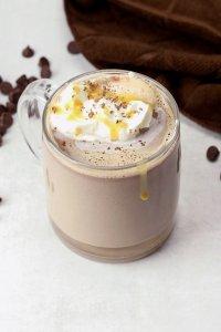 Salted caramel hot chocolate in a glass mug.