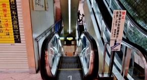 4. New Shimbashi Building escalator down