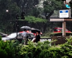 Hibiya station Tokyo rain woman 2
