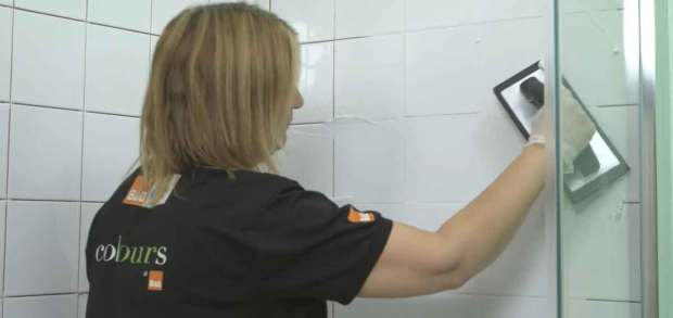 use a grout float to spread