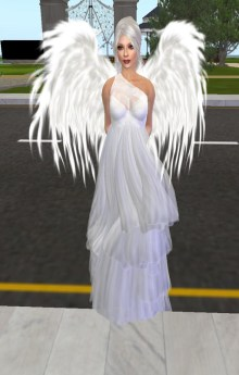 Ena Zackerly, SL's own Archangel, was found outside our office, spreading devine light through our windows.