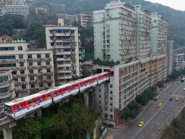 A train running through a building in Chongqing