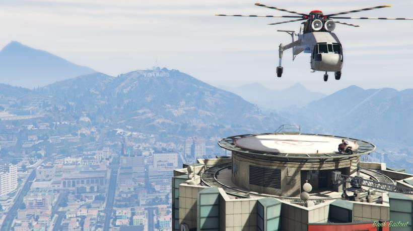The Skylift hovers above the roof of the Maze Bank Tower